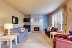 Nice living room with blue walls and carpet. Stock Photos