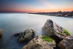 Nice long exposure seascape. Nice long exposure seascape with rocks covered with moss Stock Images