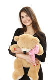 Nice long-haired girl with a toy bear. Stock Photos