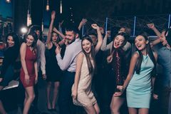 Nice-looking attractive glamorous cheerful positive elegant stylish ladies and gentlemen having fun enjoying festive. Nice-looking attractive glamorous cheerful stock photo