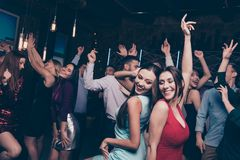 Nice-looking attractive lovely glamorous shine cheerful positive stylish smart ladies and gentlemen having fun festal. Nice-looking attractive lovely glamorous stock image