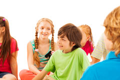 Nice looking boy in circle of friends Royalty Free Stock Photo