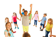 Nice looking boy stand in circle of other kids Royalty Free Stock Photo