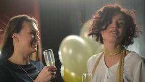 Nice-looking Brunettes are Talking to Each Other During Disco Party and Clinking Glasses with Champagne. Two Smiling. Women Have Conversation in the Club, HD stock footage