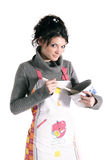 Nice-looking cook. A nice-looking woman with apron, cooking pot and stirring spoon. All isolatedon white background Stock Photo