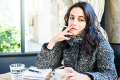 Nice looking girl smoking a sigarette Royalty Free Stock Images