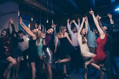 Nice-looking gorgeous attractive glamorous slim fit thin graceful cheerful positive stylish girls and guys having fun. Nice-looking gorgeous attractive glamorous royalty free stock images