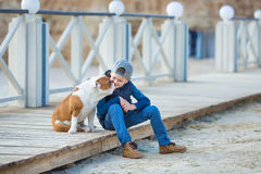 Nice looking handsome boy on beach with bulldog Royalty Free Stock Images