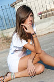 Nice looking light brunette wear a white short dress Royalty Free Stock Image