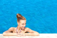 Nice Looking Slim Woman at the Beautiful Pool Stock Photo