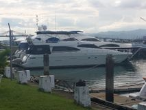 Cebu Yacht Club. A nice-looking vessel docked near a small restaurant and a small casino & x28;out of frame& x29 royalty free stock photo