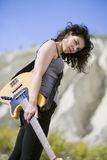 Nice looking young woman posing with guitar Royalty Free Stock Images
