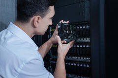Nice male technician doing his job Stock Photography