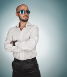 Nice man with berad and sunglasses looking away in studio Stock Image