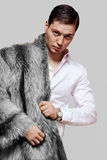 Nice man in a fur coat from a black fox Royalty Free Stock Photo