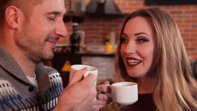 Nice man and a girl are drinking coffee and talking in a restaurant.  stock video footage