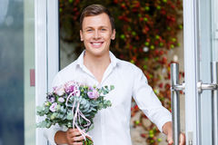 Nice man going out of flower shop Stock Photography