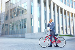 Nice man holding bicycle Stock Image
