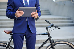 Nice man holding laptop near bicycle Stock Image
