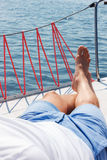 Nice man lying on yacht deck Stock Photography
