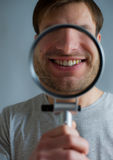 Guy with magnifying glass Royalty Free Stock Images