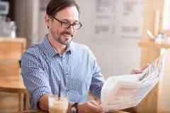 Nice man reading newspaper Royalty Free Stock Image