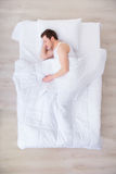 Nice man sleeping in  bed Royalty Free Stock Photos