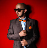 Nice man in sunglasses and suit on red background Royalty Free Stock Photo