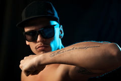 Nice man with tattoo on hand in studio Stock Images