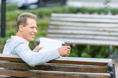 Nice man waiting on the bench Royalty Free Stock Image