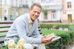 Nice man waiting on the bench Royalty Free Stock Images