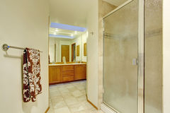 Nice master bathroom with brown cabinets Royalty Free Stock Photo