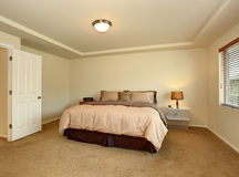 Nice master bedroom with simple decor. Royalty Free Stock Images