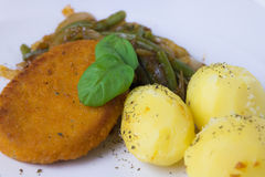 Chicken burger with basil, beans and potatoes. Royalty Free Stock Image