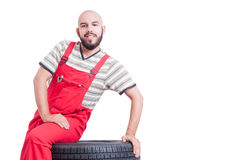 Nice mechanic waiting and sitting Stock Image