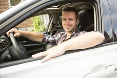 Nice men with his brand new car Royalty Free Stock Photos