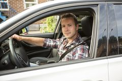 Nice men with his brand new car Royalty Free Stock Images