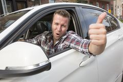 Nice men with his brand new car Royalty Free Stock Image
