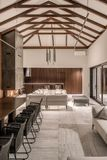 Luminous interior with different walls and wooden beams stock photography