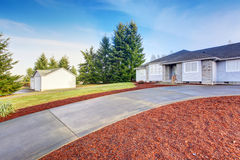 Nice modern house with driveway. Royalty Free Stock Images