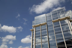 Nice modern office building and blue sky background Stock Photos