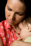 Nice mom and baby on black Royalty Free Stock Photo
