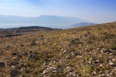 Nice mountain with sea and clear blue sky, island Krk, Croatia royalty free stock image