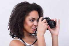 Nice mulatto woman taking photos Royalty Free Stock Photos