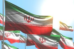 Nice national holiday flag 3d illustration - many Iran flags are wave against blue sky image with bokeh. Nice many Iran flags are wave against blue sky royalty free illustration