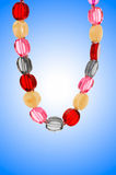 Nice necklace against gradient Royalty Free Stock Photos