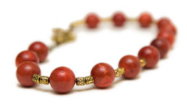 The nice necklace with red beads isolated on white background Stock Photos