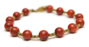 The nice necklace with red beads isolated on white background Royalty Free Stock Photography