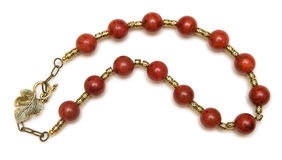The nice necklace with red beads  on white background Stock Images