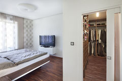 Nice new bedroom with storage space Stock Image